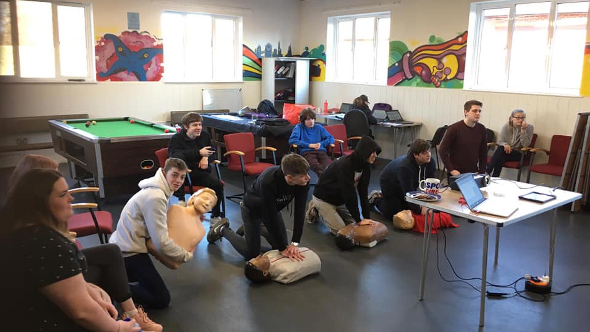 Wealden Works group learning first aid techniques